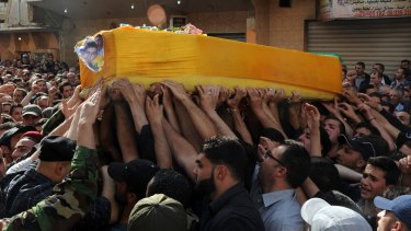 Mourners in Lebanon's Bekaa Valley carry the coffin of Hezbollah fighter Hassan Faisal Shuker, killed fighting Syrian rebels at the Syrian town of Qusayr in 2013.