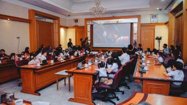 Pupils of the Domba Kecil school watch a scene from <i>Finding Nemo</i> with Jakarta governor Basuki Tjahaja Purnama in city hall in April last year.