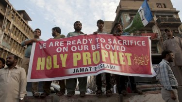 Supporters of Pakistani religious party Jamat-e-Islami rally for Mumtaz Qadri in Karachi last week.