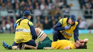 Wallaby down: Kane Douglas is treated for injury during the 2015 Rugby World Cup Final.