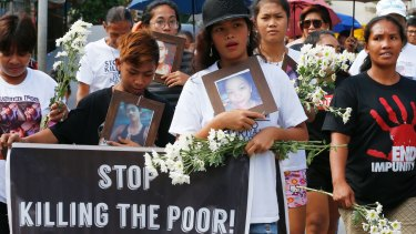 """Relatives of three youths killed in Duterte's war on drugs mark the Roman Catholic """"Day of the Innocents""""."""