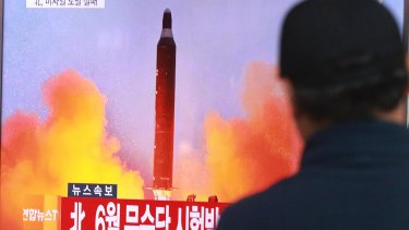 A man in Seoul watches a TV news program on North Korea's missile launches last year..