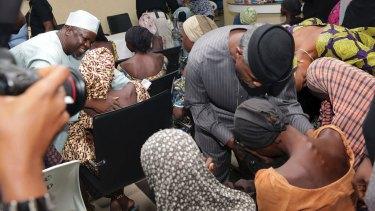 Nigerian Vice President Yemi Osinbajo, right, welcomes some of the freed Chibok school girls in Abuja in October 2016.