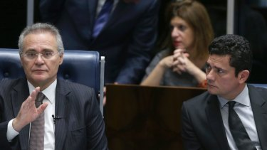 Brazil's Senate President Renan Calheiros, left, and Brazilian Federal Judge Sergio Moro, who is leading the Petrobras corruption attend a Senate session in Brasilia on Thursday.