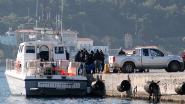 Coast guard vessel arrives with the dead bodies of refugees at the port of Vathi on the Greek island of Samos on Thursday. At least 24 people drowned when their boat sank.