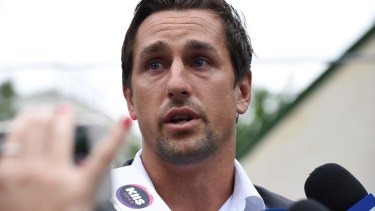 Facing the music: Mitchell Pearce addresses the media on Friday afternoon.