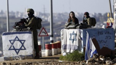 Israeli soldiers stand guard outside settlements in the occupied West Bank in March. The Republican platform rejects the notion that the territory is occupied.