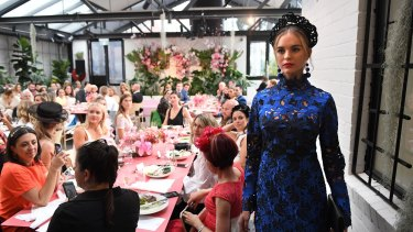 Models strut the runway at the Myer spring racing launch in Melbourne on Friday.