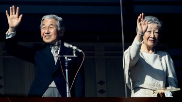 Emperor Akihito and Empress Michiko greet well-wishers gathered to celebrate the Emperor's 76th birthday in 2009.