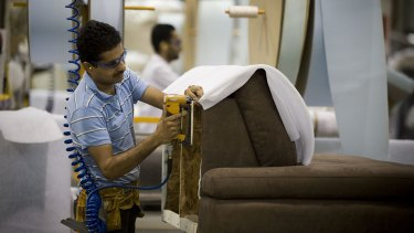 An immigrant employee at a furniture factory in Manitoba, Canada.