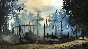 Smoke rises from a burnt house in Gawdu Zara village, northern Rakhine state, Myanmar, in September, after retaliatory attacks for Muslim attacks on security posts.