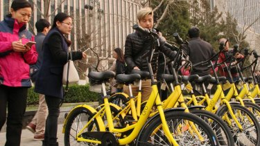 Commuters unlock shared bikes using their smartphones in Beijing.