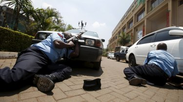September 2013: policemen take cover near the main entrance of the Westgate shopping mall during the attack that killed at least 67 people.