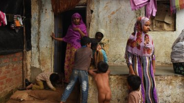 Women and children at a camp  for 71 Rohingya families in India.
