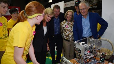 Australian Prime Minister Malcolm Turnbull (right) along with Foreign Minister Julie Bishop (second from left) and Assistant Minister Craig Laundy (middle) and wife Lucy Turnbull meet with competitors as they tour the FIRST Global Robotics Competition in Sydney.