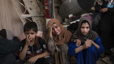 Fleeing Iraqi civilians. Iraqi police and army units have relied heavily on air strikes to make progress, but this has resulted in high civilian casualties.