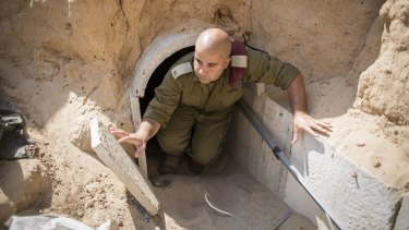 An Israeli soldier emerges from a tunnel built by Hamas militants leading from the Gaza Strip into southern Israel in August 2014.