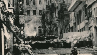 Sandbags divide a street in the Bab Idriss area of Beirut in April 1976, a year after the war began.