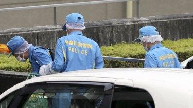 Police investigators after the knife attack in Sagamihara, Japan.