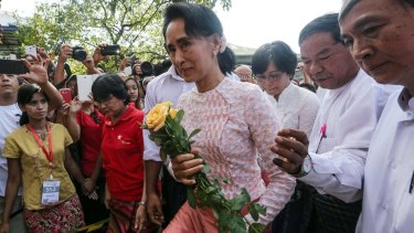 Aung San Suu Kyi, Myanmar's opposition leader and chairperson of the National League for Democracy (NLD), arrives at the party headquarters in Yangon on Monday.