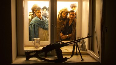 Afghans look through the window into the bedroom of Taliban spiritual leader Mullah Omar in his compound on the outskirts of the Afghan city of Kandahar in 2001.