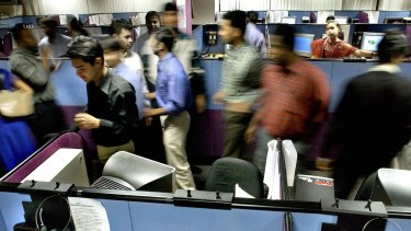 Indian employees at a 24-hour call centre in Bangalore. India's technology-related sectors are growing rapidly but unemployment grows faster.