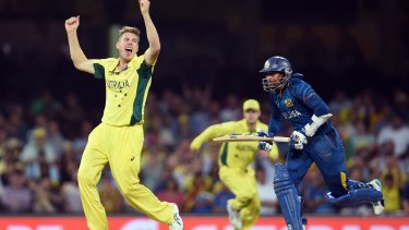 You beauty: James Faulkner celebrates after dismissing Sri Lanka batsman Tillakaratne Dilshan on Sunday.