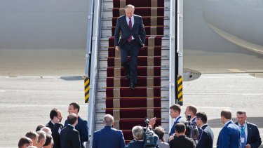 Russian President Vladimir Putin steps down from his plane at Mehrabad Airport, in Tehran.