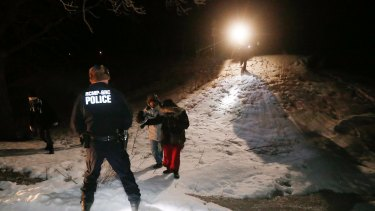 Migrants from Somalia are arrested and detained by RCMP after crossing into Canada illegally.