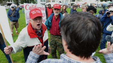 Trump supporter Jim Templeton, left, yells at an anti-Trump protester at a dual rally for and against President Donald Trump on  March 4.