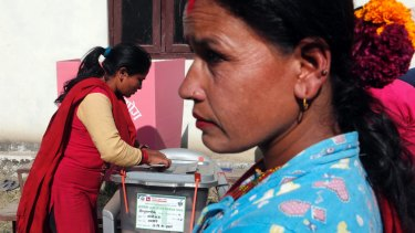 A Nepalese woman casts vote during the legislative elections in Balefi, Nepal, on Sunday.