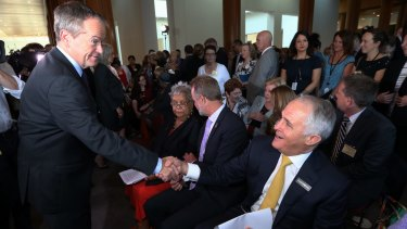Mr Turnbull and Opposition Leader Bill Shorten came together at the breakfast event.