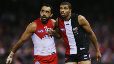 Adam Goodes and St Kilda's Jason Holmes contest on Sunday.