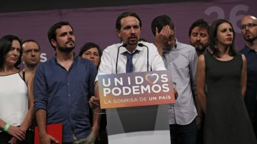 Dejected supporters of the anti-austerity Unidos Podemos coalition at a news conference in Madrid following the results.