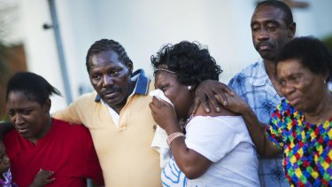Gary and Aurelia Washington, centre left and right, the son and granddaughter of Ethel Lance who died in the Charleston shootings.