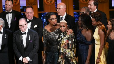 Producer Scott Sanders, left, accepts the Tony Award for best revival of a musical for 'The Color Purple' with his cast and creative team including Oprah Winfrey, centre.