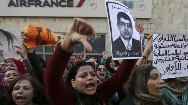 """Protesters hold a poster of Egyptian Interior Minister Mohamed Ibrahim with the words """"Wanted: the killer of Shaima al-Sabbagh""""  in Cairo. Police have denied responsibility for her shooting."""