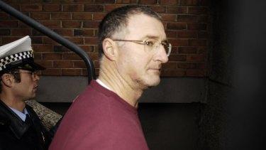 Potter in Tasmanian police custody in 2008.