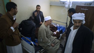 Relatives of Sheikh Sulieman Ghanem, 75, centre, surround him as he receives medical treatment on Friday.