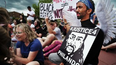 Protesters in St Anthony, Minnesota, in June after the verdict in the Philando Castile case.