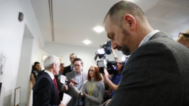 Sean Black listens during a Malcolm Roberts press conference.