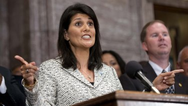 South Carolina Governor Nikki Haley speaks during a ceremony where she signed a bill to remove the Confederate flag from the Statehouse grounds more than 50 years after the rebel banner was raised to protest the civil rights movement.
