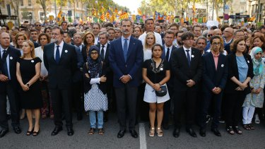 Spainish King Felipe, centre, Spainish Prime Minister Mariano Rajoy, third from left, and Catalonia regional President Carles Puigdemont, fourth from right, attend a demonstration condemning the Barcelona terrorist attacks.