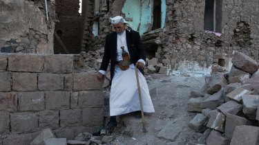 An elderly man passes destroyed homes in the old city of Sanaa in Yemen.