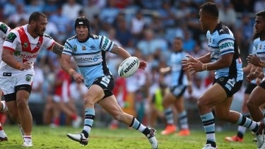 Sending it wide: Michael Ennis passes during the round two NRL match between the Cronulla Sharks and the St George Illawarra Dragons at Southern Cross Stadium.