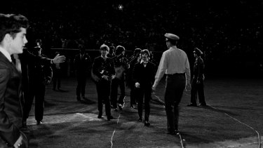 The Beatles walking to the stage at Candlestick Park in San Francisco.