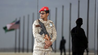 Saudi soldiers stand guard during US President Barack Obama's arrival in Riyadh.