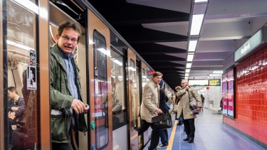 Commuters arrive at Maelbeek metro station in Brussels on April 2016 for the first time since the March 22 attacks.