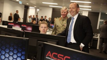 Mr Abbott on a tour of the new centre.