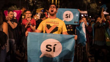 Catalan independence supporters gather in Barcelona's main square on Sunday.